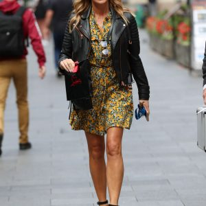 Actress Amanda Holden Yellow Floral Dress and Leather Jacket